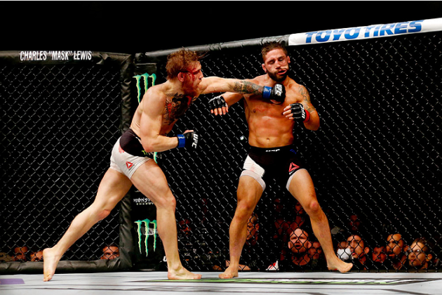 LAS VEGAS, NV - JULY 11: (L-R) Conor McGregor punches Chad Mendes in their UFC interim featherweight title fight during the UFC 189 event inside MGM Grand Garden Arena on July 11, 2015 in Las Vegas, Nevada. (Photo by Christian Petersen/Zuffa LLC/Zuffa LLC via Getty Images) *** Local Caption *** Chad Mendes; Conor McGregor'