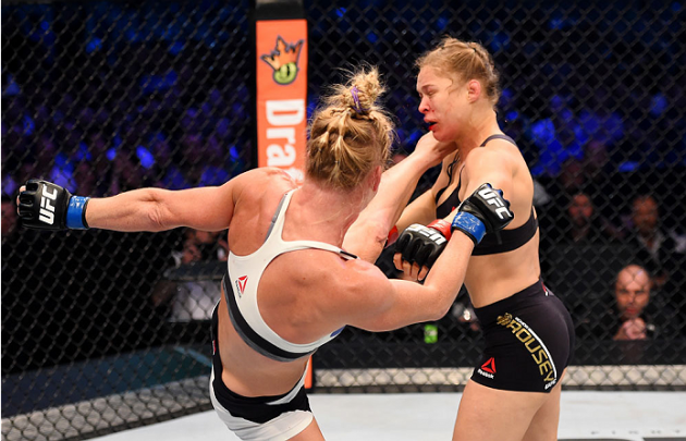 MELBOURNE, AUSTRALIA - NOVEMBER 15: (L-R) Holly Holm lands a left-high kick against Ronda Rousey in the second round of their UFC women's bantamweight championship bout during the UFC 193 event at Etihad Stadium on November 15, 2015 in Melbourne, Australia. (Photo by Josh Hedges/Zuffa LLC/Zuffa LLC via Getty Images)