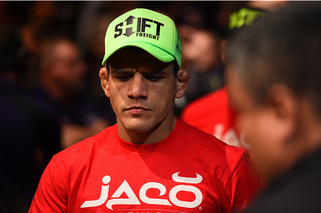 PHOENIX, AZ - DECEMBER 13: Rafael dos Anjos of Brazil enters the arena before facing Nate Diaz in their lightweight fight during the UFC Fight Night event at the U.S. Airways Center on December 13, 2014 in Phoenix, Arizona. (Photo by Josh Hedges/Zuffa LLC/Zuffa LLC via Getty Images)